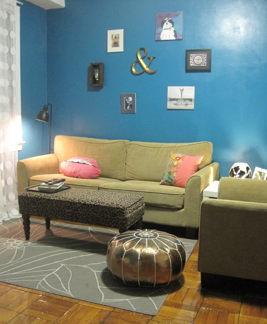 blue living room paint, peacock blue paint, frame arrangement